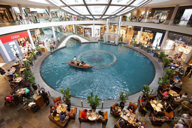 Singapore. Marina Bay Sands. The Shopping Mall. Gondolas on channels.
